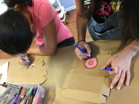 "Campers are designing logos for their ""future"" pastry shops."